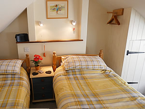 Twin bedroom in the Bolthole holiday cottage